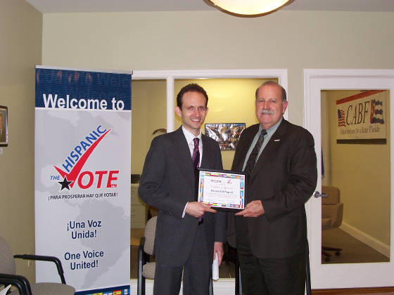Cuban Americans for a Better Florida Chairperson, Rafael Lopez, presents Certificate of Appreciation to Richard DeNapoli